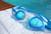 Swimming Goggles At The Edge Of A Swimming Pool