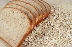 stock photo of whole-grain  - slices of bread layed out on oats - JPG