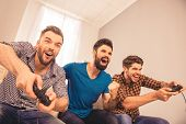 Yeah! Excited Happy Cheerful Men Play Video Game With His Friends poster