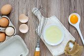 Fresh Farm Eggs On A Wooden Rustic Background. Separated Egg White And Yolks, Broken Egg Shells. Whi poster