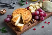 Cheese Platter With Assorted Cheeses, Grapes, Nuts Over Black Background, Copy Space. Italian Cheese poster