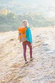 Woman With A Backpack poster