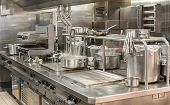 Food Being Cooked In Commercial Stainless Steel Kitchen In Restaurant poster