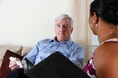 picture of counseling  - Woman Counseling a Man in Her Office - JPG