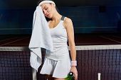 Portrait Of Female Tennis Player Wiping Sweat With Towel  Taking Break From Practice In Indoor Court poster