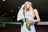 Waist Up Portrait Of Female Tennis Player Wiping Sweat With Towel  Taking Break From Practice In Ind poster