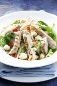 stock photo of caesar salad  - Chicken Caesar salad on blue - JPG