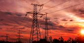 High-voltage  Power Lines At Sunset. Electricity Distribution Station. High Voltage Electric Transmi poster