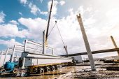 Details And Tools On Construction Site With Crane Lifting Prefabricated Concrete Framework, Unloadin poster