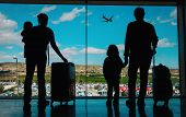 Family With Kids And Luggage Looking At Planes In Airport, Travel Concept poster