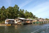 stock photo of surigao  - Native Huts along a river in Surigao del Norte Philippines - JPG