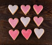 Nine Frosted  Heart Cookies In Grid With Gradients Of Pink Icing poster