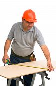 isolated worker using a tape measure