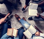 Group christianity people reading bible together poster