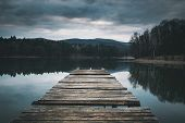 Mole (pier) On The Lake.  Wooden Bridge In Forest In Spring Time With Blue Lake. Lake For Fishing Wi poster
