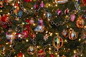 foto of christmas ornament  - A photo of a section of a Christmas tree laden with colorful and expensive ornaments - JPG