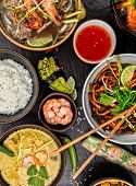 Постер, плакат: Asian food variation with many kinds of meals Kari rice noodles and vegetable Top view served on