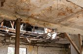 Damaged House. Collapsed Roof Of The Total Damaged Domestic House Indoor From Natural Disaster Or Ca poster