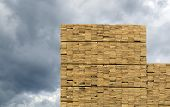 Lumber Industry - Abstract Background - Finished Lumber Against Overcast With Clouds. poster