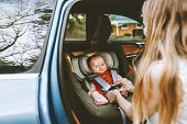 Baby In Car Mother Fastens Belts Of Safety Car Seat Family City Lifestyle Road Trip Vacations Childc poster