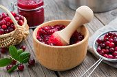 Wooden Bowl Of Crushed Cranberries, Basket Of Bog Berries, Jar Of Crushed Berries, Jam Or Sauce And  poster