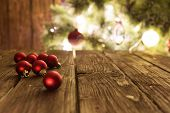 Goup Of Colorful Christmas Baubles On Wooden Table. Christmas Decorations On Wooden Surface poster