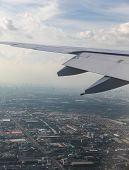 Modern Airplane Landing At Bangkok Suvarnabhumi Airport, View From Airplane, Bangkok Skyscrapers In  poster