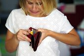 Unhappy Woman Holding An Empty Wallet. Young Caucasian Woman With Empty Wallet. poster