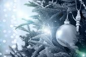 Close Up Of Beautiful Christmas Decoration- Bauble Christmas Silver Ball Hanging On The Christmas Tr poster