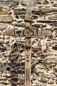 Old Wooden Cross With The Symbols Of The Passion Of Christ, Pincer, Ladder, Hammer, Chalice, Spear,  poster