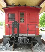 stock photo of caboose  - Red caboose is last car on steam locomotive - JPG
