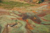 Vivid Multicolor Nature Background Of Colorful Highland Stony Valley. Full Frame Surface Of Big Moun poster