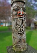 stock photo of indian totem pole  - Totem pole carved from cedar Thunderbird Park Victoria BC Canada - JPG