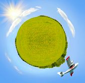 pic of swales  - plane flying in sky around green planet sunny day square photo - JPG