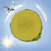 image of swales  - plane flying in sky around green planet sunny day square photo - JPG
