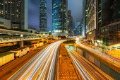Long Exposure Of Hong Kong Cityscape Skyscaper Which Have Light Traffic Transportation From Car Or B poster