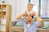 family, parenthood and fatherhood concept - happy father riding little baby daughter on his neck at  poster