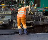 picture of road construction  - Road worker at the asphalt repairing works - JPG