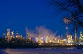 image of flux  - Oil and petroleum refinery along frozen Mississippi River in St - JPG