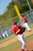 image of little-league  - Little league baseball pitcher looking at third. ** Note: Slight blurriness, best at smaller sizes - JPG