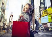picture of going out business sale  - young woman goes shopping in New York City - JPG
