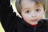 stock photo of innocent  - Three year old portrait of innocence outdoor in the sunlight - JPG