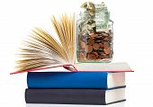 picture of degree  - Books with penny jar filled with coins and banknotes  - JPG