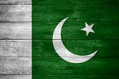 stock photo of pakistani  - flag of Pakistan or Pakistani banner on wooden background - JPG