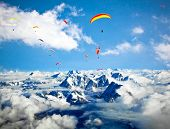 foto of float-plane  - Paraglider flying against the Himalayas - JPG