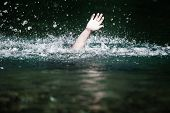 stock photo of sos  - Moving Hand of Someone Drowning and in Need of Help - JPG