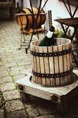 stock photo of wine-press  - Ancient wooden wine press in outdoor setting - JPG