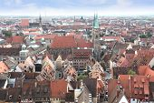 stock photo of bavaria  - View over the old town of Nuremberg with the spires of St Sebald church and St Lorenz church the town hall and the opera house in Franconia Bavaria Germany - JPG