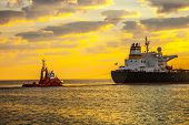 picture of fuel tanker  - Tug boat pulling the tanker ship at sea - JPG
