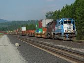image of bnsf  - a westbound stack train led by emd 9099 flies along the bnsf tracks in id - JPG